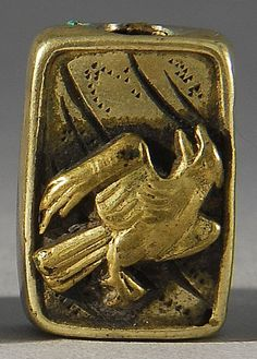 Lot 91: BRASS AND SILVER METAL OJIME In rectangular form with relief bird design. Length 18mm. - Eldred's | Invaluable