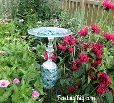 Butterfly Feeder with Feeding Big.  This butterfly feeder is made with Dollar Tree items and a few items I had in my home.  Easy to make and beautiful in your garden.  Get your children to help!