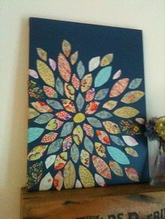 Flower made with fabric scraps on canvas