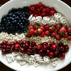 4th of July fruit tray with yogurt covered raisins and Pretzels, strawberries,  cherries,  blue berries and raspberries.