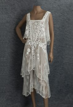 This mixed lace tea dress from 1929 combines handmade Brussels lace, embroidered net lace, and hand-assembled tape lace.