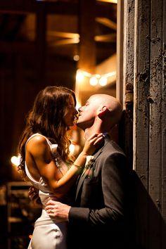 Newlyweds passionately kiss, Roey Yohai Photography