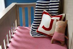 Contemporary Kids' Room: Striped bedding in a child's crib. .