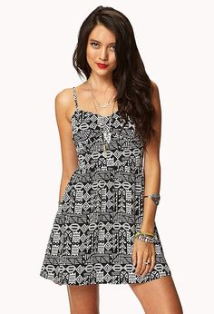 Style Deals- A woven dress featuring a tribal-inspired pattern. Sweetheart neckline. Ruched shape...