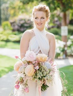 Pretty pink wedding dress + fun wild bridal bouquet