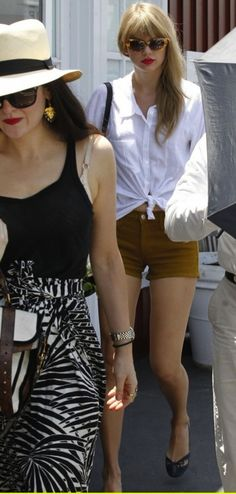 I love the lady in the hat and black and white print.    Taylor Swift in casual shorts & a white top.