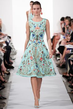 Embroidered light blue floral dress from Oscar de la Renta SS2014 collection.  A wild garden beautifully interpreted on to a dress. With so many colours present it's easy to match with any shoes. Only rule: keep jewellery simple.