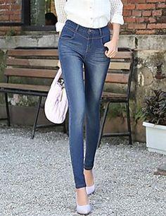 alta cintura de los pantalones vaqueros elásticos de las mujeres