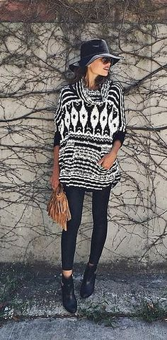 A wool fedora, chunky statement sweater, skinny jeans, and boots.