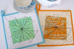 Free-motion quilted potholders from my Modern Patchwork article on mid-century modern quilting
