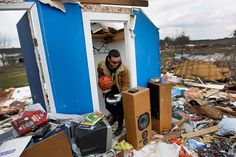 Amando Gomez finds his basketball in the closet of what used to be his bedroom after his families home was destroyed by a tornado on March 4, 2012 in Marysville, Indiana. Severe weather and tornados have swept across the U.S. causing heavy damage and multiple deaths. (Photo by Joe Raedle/Getty Images)