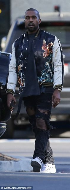 Walking advert! The Grammy winner donned a colourful silk bomber jacket from his own Yeezy collection