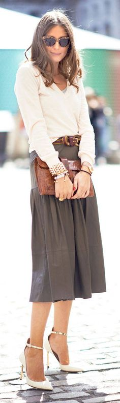What takes this plain v sweater and midi skirt out of the ordinary? Sexy strap pumps, leather belt, wonderful leather clutch and a host of interesting bracelets.