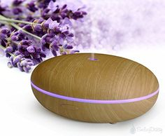 Essential Oil Diffuser By Smiley Daisy® - Whisper-Quiet Cool Mist Humidifier - Enjoy Aromatherapy Experience with Your Favorite Scented Essential Oils - Free eReport Download - Ultrasonic Vaporizer with Excellent Mist Disperse Rate - Enlightening 7 Color Changing LED Lamp - Best Candle Burner Replacement - Oval-Shaped Oil Diffuser with Elegant Finish Housing - 180-Day Product Replacement Warranty When You Purchase with Smiley Daisy (Walnut Brown)