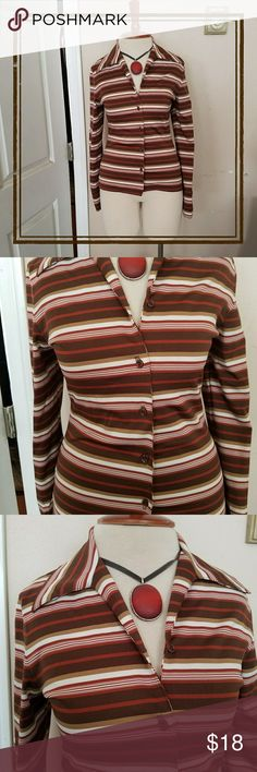 🌻Vintage Fitted Funky Striped Poly Blouse🌻GROOVY This funky poly blend button down is in great vintage condition, no flaws noted. The fabric is a bit thicker and matte, allowing it the hug your body and stay put.  Classic combo of browns and white in flattering stripes.  An oversized collar finishes the look. Brand is Coolwear and is sized a medium.  Meant to be form fitting, as my mannequin is a 6 and it hugs her curves. Made in the USA. Vintage  Tops Button Down Shirts