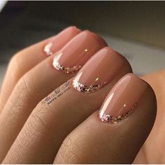 Silver glitter and a lighter nude/pink polish. Love this look. Simply elegant.