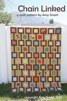 Love this quilt pattern!  Thinking black and white with red squares.  Buy the pattern on this site