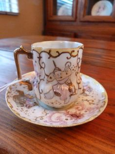 Vintage Hand Painted Tea Cup and Saucer Demitasse.