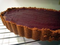 Dark chocolate tart with a ginger snap crust. This rich, super-chocolatey tart is a great make-ahead dessert. Serves many because it is so rich; the tiniest sliver is more than enough!