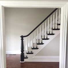 Our teeny little entry is finally repainted! Spindles, rails, walls. Whew! So tired of painting things.  the color: Revere Pewter by Benjamin Moore.  #reverepewter #entry #staircase #foyer #stairstories