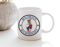 These ceramic mugs are available in 11 oz standard or 15 oz jumbo size. UV Protected, FDA Compliant, Microwave and Dishwasher Safe. Wooden Greek Letters, Kappa Kappa Psi, Bid Day, Ceramic Mugs, Sorority, Dishwasher, Seal, Ceramics, Alpha Delta