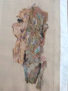 Buttonhole stitch using various threads over scorched silk. By Debbie Irving