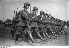 Reichswehr troops parade in 1930. Limited to 100,000 men, the Reichswehr was top priority in Hilter's plans for radical change in the direction of bringing war upon all.