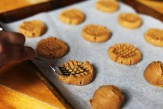 Flourless PB cookie. 4 ingredients. light crisp on the outside, soft on inside. (note: can reduce sugar by 1/2)