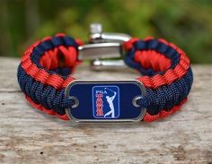 This is the officially licensed Regular Survival Bracelet of the PGA TOUR®! Made from super strong military spec paracord and a military dog tag. $41.90  www.survivalstraps.com