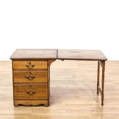 This kneehole desk is featured in a solid wood with a distressed oak finish. This traditional style workstation has 3 spacious drawers, carved spindles, and bronze drop handle pulls. Perfect for students who need a place to study! #americantraditional #desks #kneeholedesk #sandiegovintage #vintagefurniture