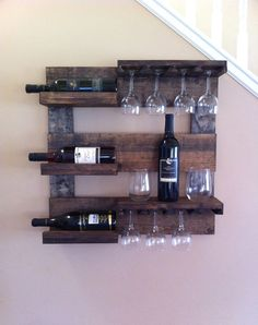 This beautiful wine rack is made from reclaimed pine that I have stained and distressed. It measures 24 x 24 with 3 shelves and wine glass holder.