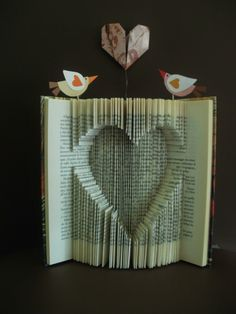 clara maffei: folding and cutting book pages. Altered book art. #heart