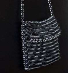 Chainmail Purse in Black Neoprene and Aluminum. $150.00, via Etsy. Loving this color combination, and it's more doable price-wise than using anodized aluminum colors.