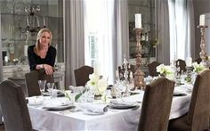 Right on the 20-seater dining table, which was custom-made by Rupert Bevan, the tall wooden candlesticks are from Maison Artefact, and the French crystal candelabra are from Matthew Upham