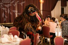 Anna and Spencer Photography, Shisa Dog Dance at a Wedding Reception in Okinawa Japan. the shisa is a liiitle bit scary