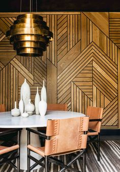 Stunning dining room design with detailed wooden walls | Katie Martinez Design