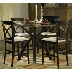 """Homelegance Cantor 5 Piece Counter Dining Room Set w/ Curved X-Base by Homelegance. $546.39. Curved """"X"""" base design. Contemporary Style. Cantor Collection. Warm Cherry Finish. 40"""" square glass top. What is included:Counter Height Table (1)Counter Height Chair (4) With a curved """"X"""" base design topped with 40"""" square glass, the Cantor Collection is modern and sophisticated. Finished in warm cherry finish, this 5-piece dining set is available in both regular height a..."""