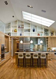 Tyrol Hills Modern Kitchen. Louis Poulsen lights hanging from ceiling