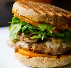 Jack-o-Pumpkin Breakfast Sandwich.  Recipe is vegan version.  Sweet maple pumpkin butter on grilled whole wheat English muffin.  Vegan breakfast sausage with black pepper & olive oil.  Grilled mushrooms on vegan Monterey Jack cheese with a pile of crisp, spicy arugula.  Serve with pumpkin spice latte or pumpkin spice chai.
