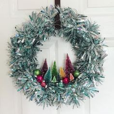 My friend Nicole made this and I love it SO MUCH. She based hers off of: http://craftandtell.com/mid-century-inspired-wreath/
