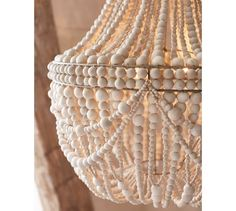 Whitewashed wood beads give the Francesca Chandelier a fresh, summery look. Whether in a dining room or a seating area, it's a natural complement to any decor style. Pottery Barn Chandelier, Wood Bead Chandelier, Shell Chandelier, Chandeliers, Chandelier Lighting, Handmade Lamps, Whitewash Wood, Idee Diy, Decor Styles