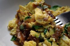 PrintScrambled Eggs with Smoked Gouda, Caramelized Onions and Arugula Serving Size: Makes 2 servings Ingredients4 eggs, scrambled 1 small sweet onion, thinly sliced 1 cup tightly packed baby arugula leaves 1/2 cup shredded smoked gouda salt red pepper InstructionsCoat a medium non-stick skillet with a thin layer of olive oil, and sauté the onions over …