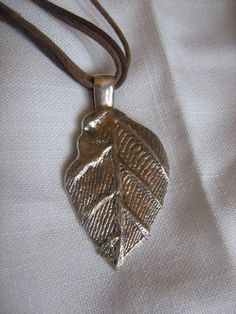 Silver leaf pendant cast from cuttlefish mould.