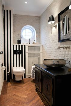 Black and white bathroom. Love the sink.