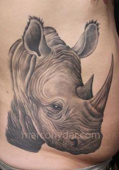 rhino tattoo meanings itattoodesigns com tats pinterest rh pinterest com tribal rhino tattoo meaning rhino beetle tattoo meaning