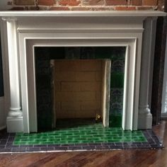 Exactly like our fireplace (but nicer!) Love the emerald green tiles