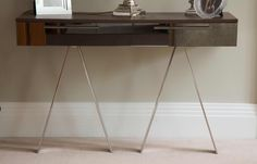 Side / console table in fumed oak, stainless steel legs and smoked mirror draw front
