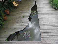 I may be pinning this water feature but I really don't like it - horrible shape, I'm thinking splinters here - they're just trying too hard to be gimmicky.  The decking will go rotten and it will look out-of-date in the blink of an eye!