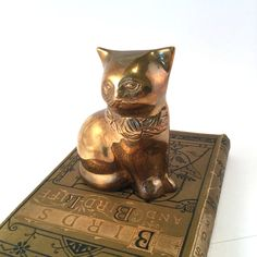 A personal favorite from my Etsy shop https://www.etsy.com/ca/listing/269666961/vintage-brass-cat-figurine-patina-and
