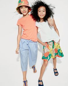 J.Crew girls' supersoft T-shirt, striped culotte, bucket hat in punchy hibiscus and neon T-strap sandals. J.Crew girls' flutter-sleeve tank top, pull-on skirt in punchy hibiscus and kids' Birkenstock® waterproof EVA Rio sandals.